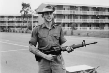 Griffo with an M16